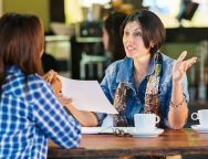 women-having-business-meeting-or-interview-in-local-coffee-shop-524373405-57d7142f5f9b589b0a44ab88